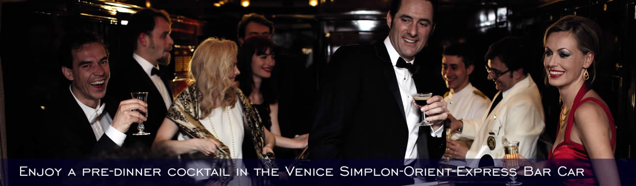 Enjoy a pre-dinner cocktail in the Venice Simplon-Orient-Express</a></em> Bar Car