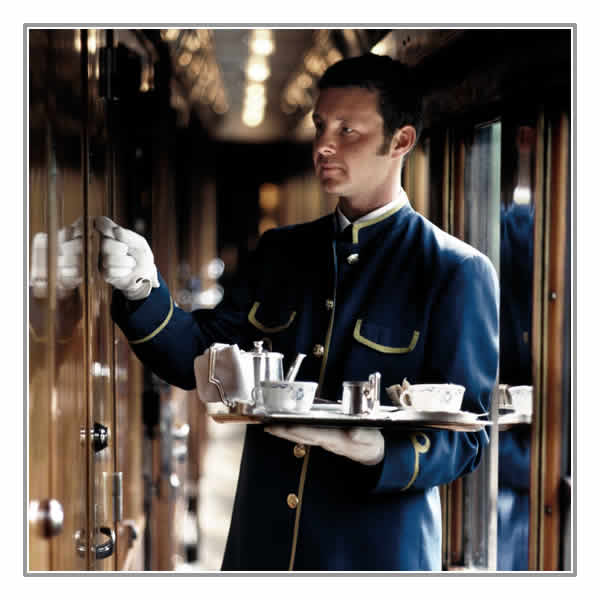 Your Belmond steward with afternoon tea on board the Venice Simplon Orient Express
