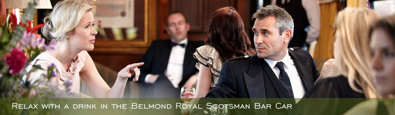 Enjoying a drink in the Belmond Royal Scotsman Bar Car
