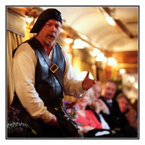A local Highlander regales stories in the Bar Car